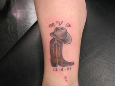 Cowboy hat and boot by Studio One Tattoo, via Flickr