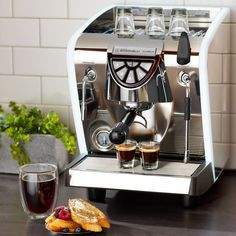 A luxury espresso machine with high performance features and an elegant, modern design.