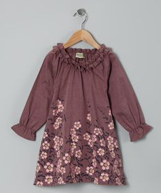 An eye-catching floral print and ruffled neckline make this stylish dress the perfect anchor for an ensemble that's sure to impress. All-cotton construction means this on-trend treasure is petal soft and a breeze to care for.