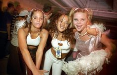 90's ravers wore metallics, pastel lipsticks, and halter necklines.