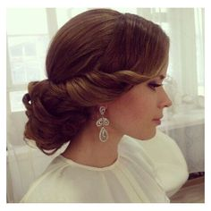Elegant wedding hair. And don't forget her beautiful earrings ❤ liked on Polyvore featuring jewelry, earrings and earring jewelry