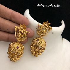 Temple jewellery available at Ankh Jewels for booking msg on 9619291911 Indian Jewelry Earrings, Gold Jhumka Earrings, Jewelry Design Earrings, Gold Earrings Designs, Gold Jewellery Design, Ear Jewelry, Gold Jewelry, Temple Jewellery, Mangalsutra Bracelet