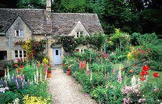 SuperStock - Bibury Cotswolds english cottage garden in summer Gloucestershire England UK Great Britain United Kingdom British Isles