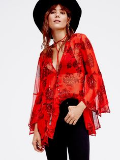 Dragon Time Tunic | Printed sheer tunic with a beautiful bohemian feel. Easy flowing shape with a ruffled hem and retro-inspired flared sleeves. Shell button closures and subtle beading at the trim and on the front ties. V-neckline. Lightweight, crinkly fabrication.