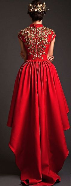 A truly royal red gown, embellished in gold to match the crown