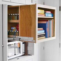 Interesting hidden book shelf, spice rack, and microwave storage (note the doors that can be pulled out to hide the whole unit)