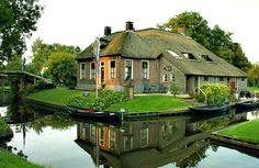 Giethoorn, Netherlands. An network of canals wind their way through the village that hardly has any drivable streets.
