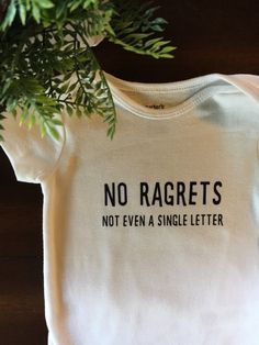 65c529ca No Ragrets, not even a single letter onesie and bodysuit! This memorable  line from