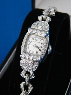 vintage  hamilton watch Woman should go back to elegant watches not those watches that look like they are going off to war.