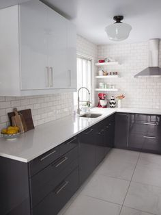 black cabinets, white glass subway tile