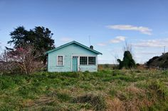 A house on next to the Manutai Marae, south of Nuhaka, Hawkes Bay. The house appears abandoned, but is in relatively good condition. It may possibly be used by the adjacent Marae Abandoned Places, New Zealand, Shed, Outdoor Structures, Cabin, Explore, House Styles, Photograph, Home Decor