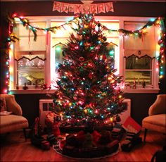 A retro Christmas; colored lights & Shiny Brite ornaments, Ives trains from the 1920's and antique Buddy L trains.