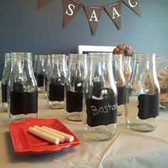 Milk bottles from Starbucks frappuccino bottles.  I added removable chalk board labels to the bottles.