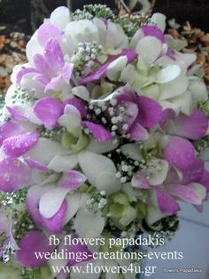 orchids in white and lila colours   by Flowers Papadakis   info@flowers4u.gr  tel 00302109426971