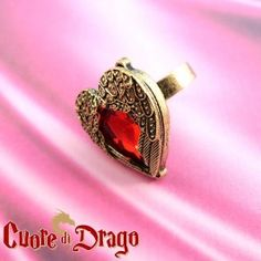 A resin ruby nestled between two wings: Cuore di Drago is a timeless ring! It looks great when you wear it with the Cuore di Drago necklace.  Find it on www.Delicute.com