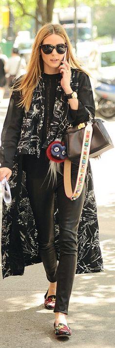 Olivia Palermo: Sunglasses – Le Specs  Coat – Chelsea28  Purse, strap, and key chain – Fendi  Shoes – Alexander McQueen