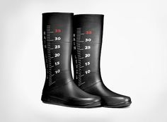 """These rubber boots are printed with playful """"rain level"""" gauge graphics, perfect for galoshing around the city on rainy days and finding the largest puddle to jump in."""