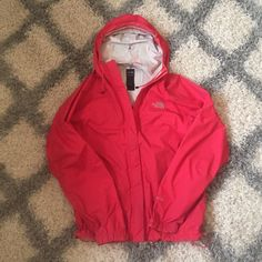 North face rain jacket Gently used north face rain jacket. Had it for a year. In great condition just a few dark spots around the cuffs. Big hood and cinching at the hem to fit it to you. The North Face Jackets & Coats