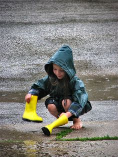 https://flic.kr/p/kWQ8Y | Waterlogged | Ember dumping the water out of her boots after splashing around in the puddles.
