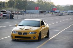 Yellow Pontiac GTO in the staging lanes at Beech Bend Raceway for Holley LS Fest
