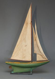 "Wooden Pond Boat with original sails 37"" long, 8"" wide, 58 1/2"" high"