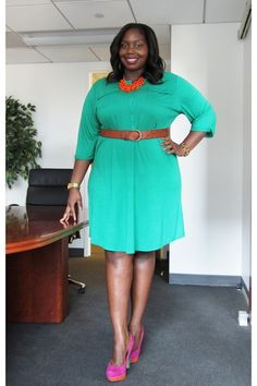 Green shirt dress, orange necklace, brown belt, pink suede color blocked pumps
