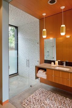 Modern 3/4 Bathroom with Complex granite counters, frameless showerdoor, 12 Inch Modern Brass Ladder Pull, Pendant Light