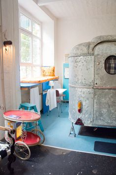 Hüttenpalast Hotel Berlin Indoor Caravan.  So, if you want to go camping this summer but prefer a really comfy hotel bed plus the urban Berlin lifestyle, Hüttenpalast is the place to go!