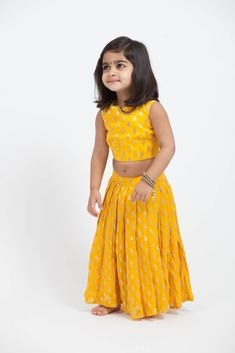 Yellow brocade open back crop top with matching lehenga. Frocks For Girls, Kids Outfits Girls, Little Girl Dresses, Girl Outfits, Girls Dresses, Baby Dresses, Girls Frock Design, Baby Dress Design, Baby Frocks Designs