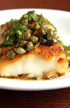 PICCATA-STYLE COD ~~~  the classic cookery method called piccata aka picatta aka pichotta begins with either veal or chicken that is sliced, coated, sauteed, and served in a sauce using pan drippings, lemon juice, white wine and/or stock, shallots, garlic, capers, slices of lemon, and finished off with butter. the dish at this post's link goes for a twist on this classic by using cod. [Italy, NonTraditional] [paleogrubs]
