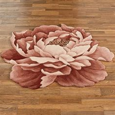 Nancy Bloom Peony Flower Shaped Rugs  These rugs are at Touch of Class.  Many themed rugs.  They look great.