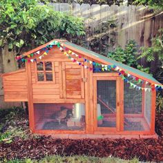 Chicken Coop...with bunting.  Of course.  Or bunny hutch with entrance to studio.  Of course!