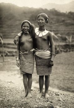 Ifugao girls posing with their pipes are tribal dancers.