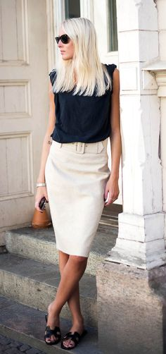 Ellen Claesson is wearing a black T-shirt from Acne, beige skirt from Zara, and shoes from Hermés