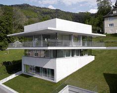 perimeter balcony wraps marte marte-designed house by the lake