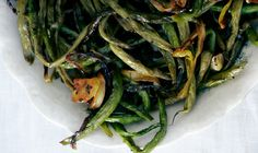"""Slow-Roasted Green Beans with Sage  2 1/2 #s green beans 3 bunches scallions 1"""" green tops attached, halved lengthwise 6 lg. garlic cloves, cut lengthwise into 4 slices <OMIT 1/2 cup olive oil> 2 T sage leaves 1 T rosemary  1 T thyme 2 tsp kosher salt pepper 375°. + 8 =bowl +pepper. Toss. Sheet pan. Roast beans, stir q 10 min =wilted, shrunken, browned at edges, ~1 hour."""