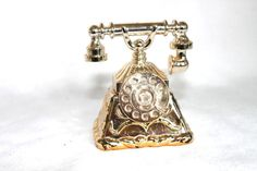 Hey, I found this really awesome Etsy listing at https://www.etsy.com/listing/152005167/avon-gold-telephone-perfume-bottle