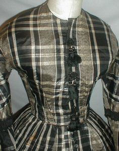 From the merchant's listing:      A fetching 1860's Civil War era black, gray and white plaid silk dress that has recently been de-...
