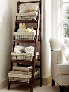 love this idea! I have always liked the ladder shelves just never thought of how I'd use it...Benchwright Ladder Floor Storage at Pottery Barn | House & Home by christine.brzycki