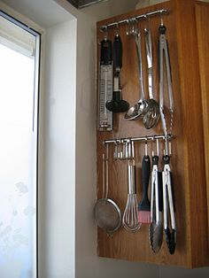 not martha — to make: my small kitchen storage Ikea Grundtal hooks hung on cabinet handles.great for kitchen with no counter space or drawers Kitchen Utensil Storage, Kitchen Hooks, Small Kitchen Storage, Kitchen Organization, Diy Kitchen, Organization Hacks, Kitchen Decor, Cabinet Storage, Kitchen Ideas