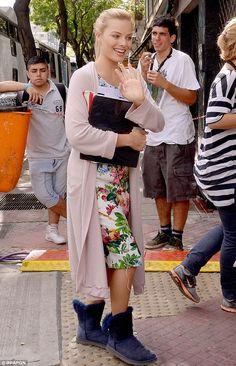 Flower power: Margot Robbie followed her co-star's lead, raising her hand to greet fans