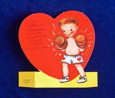 1950s Boxer in boxing gloves valentine die cut card. Made by Americard. Very cute! We love his little shoes and his shorts with hearts on them.