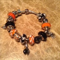Here's my Chamilia bracelet with both Pandora and Chamilia Halloween charms.