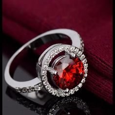 Red Garnet & White Topaz S925 Silver Ring Beautiful red Garnet Centerstone surrounded by white topaz Gemstone . sterling silver S925 stamped . brand-new never worn wrapped carefully and shipped. size 6 Fire and Ice Jewelry Rings