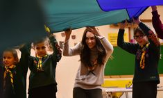 Kate bonds with children at the Cub Scouts anniversary party - HELLO! Canada