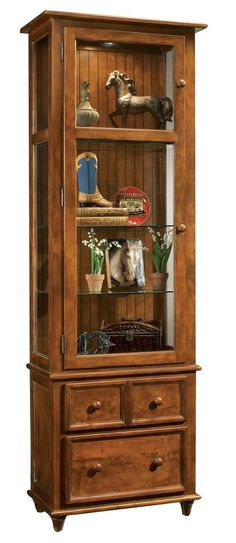 Handsomely crafted from solid hardwood, this exquisite Color Time Vista cabinet from Philip Reinisch is furniture you will be proud to own.  The rich, hand-rubbed chestnut finish is warm and inviting, and will blend with any décor.  For a different look, just ...