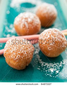 Old-fashioned doughnuts sprinkled with powdered sugar by Anna Hoychuk