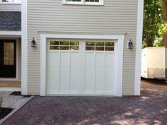Haas American Tradition model 922 Steel Carriage House Style Garage Door in White with Glazed 6 Pane Glass. Installed by Mortland Overhead Door. mortlanddoor.com