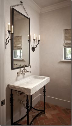 Houston's Tami Owen-designed Powder Bath:  antique marble vessel sink on a custom iron base -- Gorgeous!  Love the mirror!