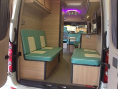 """32"""" TV and sofa (that converts into a bed) in back of converted VW camper van. busstopvw@gmail.com"""